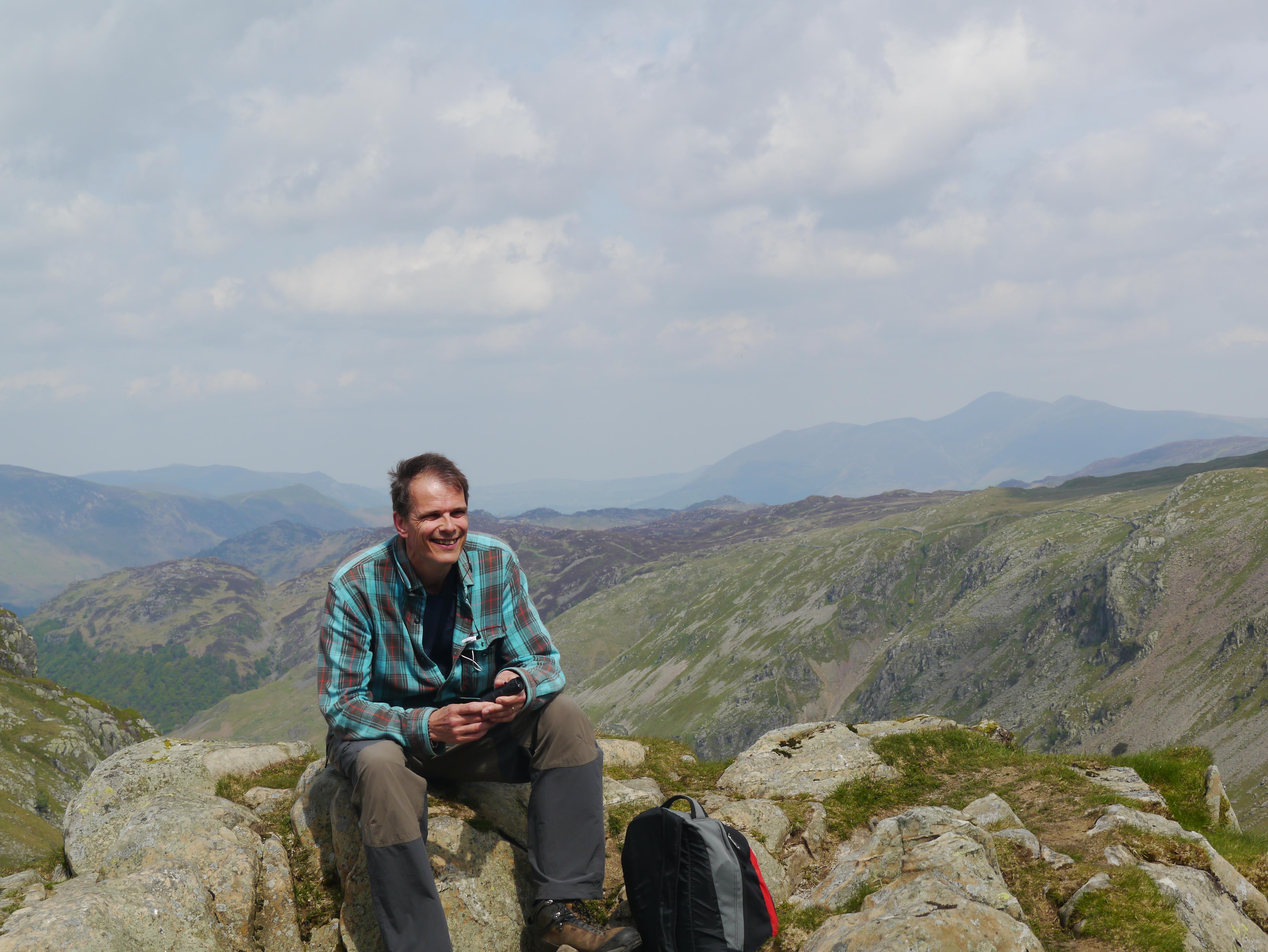 Baz on Greenup Edge, beyond Eagle Crag having a rest